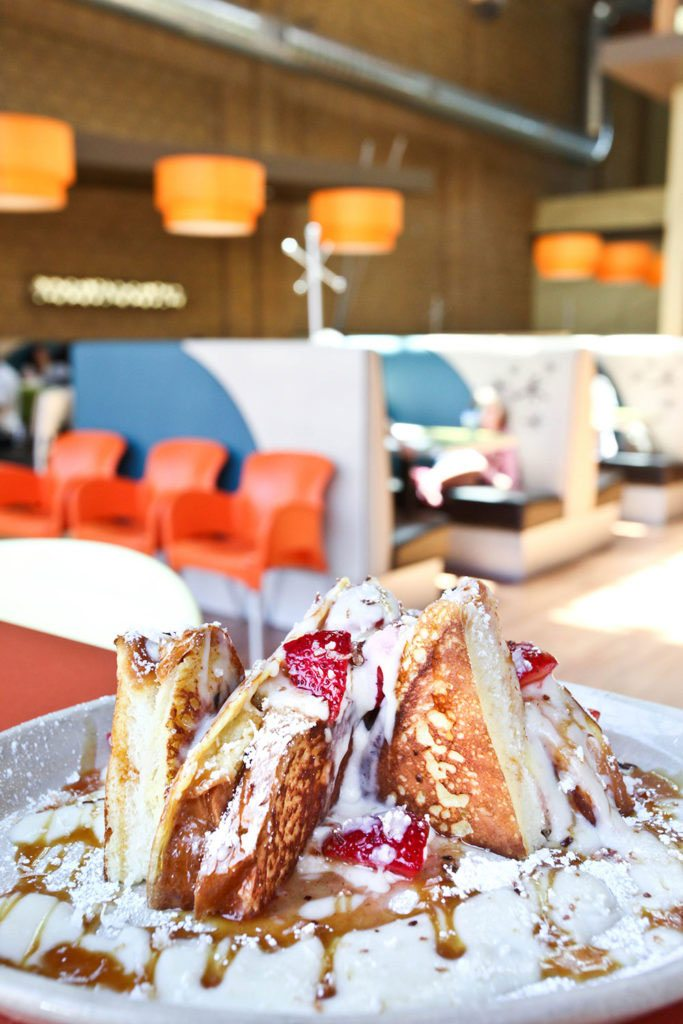 OMG! French Toast — Brioche stuffed with mascarpone then griddled and topped with vanilla crème, salted caramel, fresh strawberries and toasted coconut. Photo courtesy Jess + Matt Photography.
