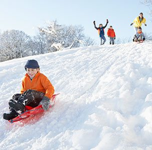 Sledding is a fun activity for your Vail family vacation