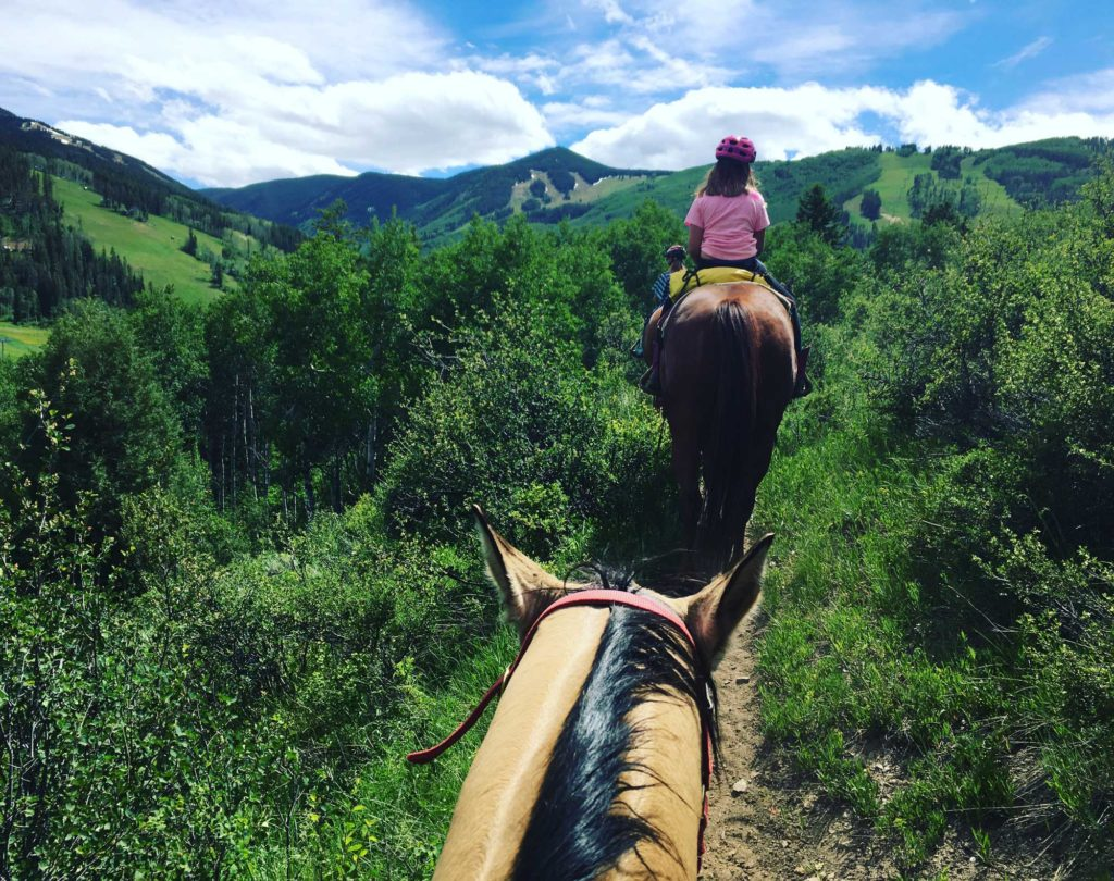The one-hour Colorado horseback riding experience took us through Aspen groves where it seemed we were in the middle of nowhere and the we would come out to spectacular mountain views.