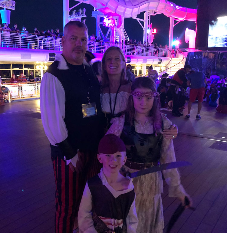 Our Disney Cruise tips include bringing costumes for the entire family for Pirate Night.
