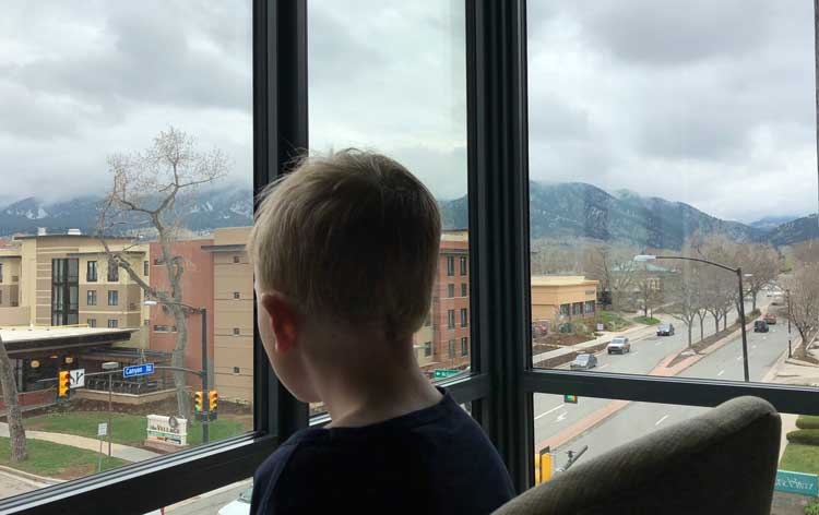 Watching life go by from a corner suite at the Embassy Suites Boulder.