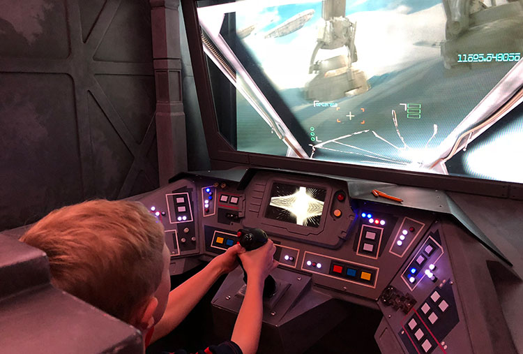 Piloting the Millenium Falcon during Star Wars Day at Sea.