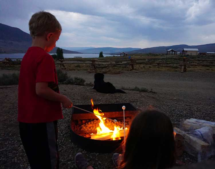 Roasting S'mores on our first family camping trip.
