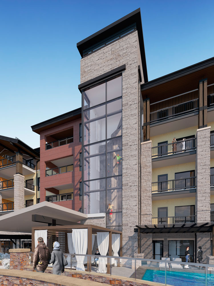 A five story climbing wall on the front of the Limlight in Snowmass, Colorado.