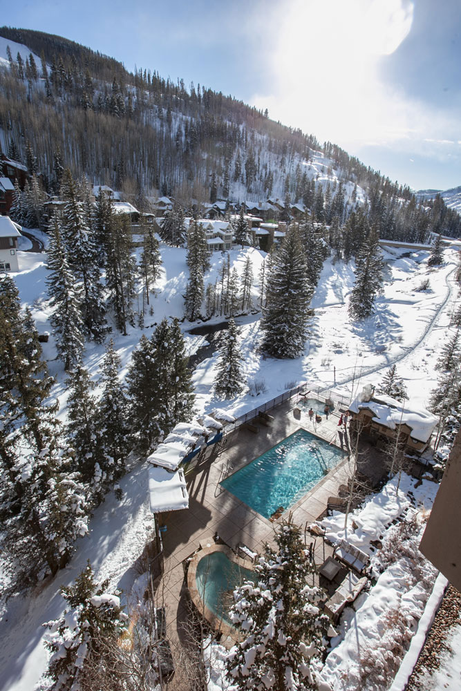 Mountain and streamside hot tubs and heated pool at the Antlers at Vail.