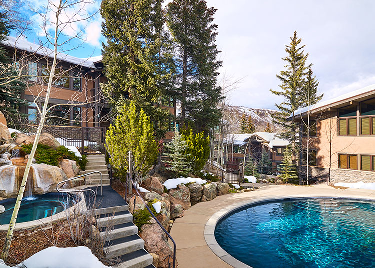 This secluded pool in Snowmass offers a fun water feature.