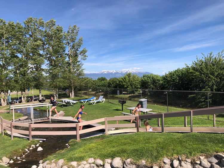 Kids playing at the Water slide at the rear of the Great Sand Dunes Swimming Pool.