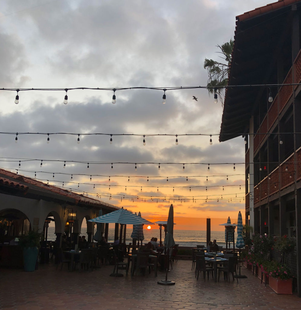 The patio at La Jolla Shores restaurant with a spectacular sunset in the background