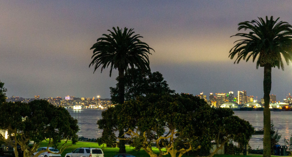 Sparking lights of downtown San Diego at night from Shelter Island.