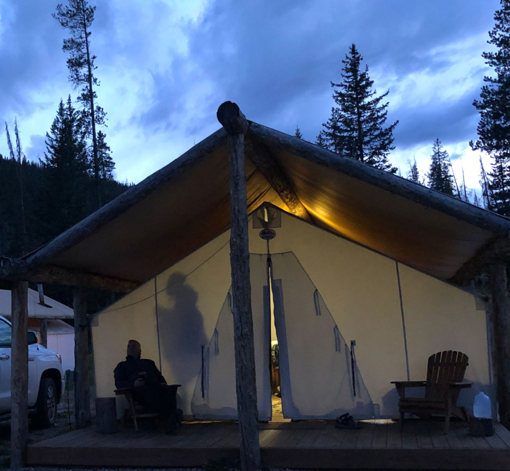 Glamping tent at Piney River Ranch at dusk.