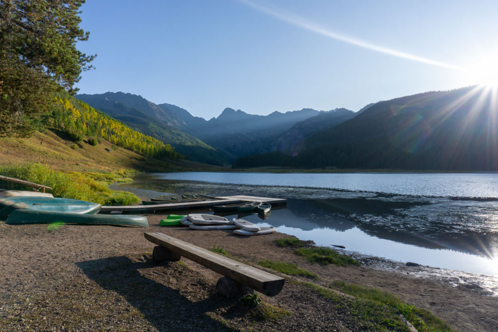Canoes and stand up paddle boards waiting to be taken out on Piney Lake.