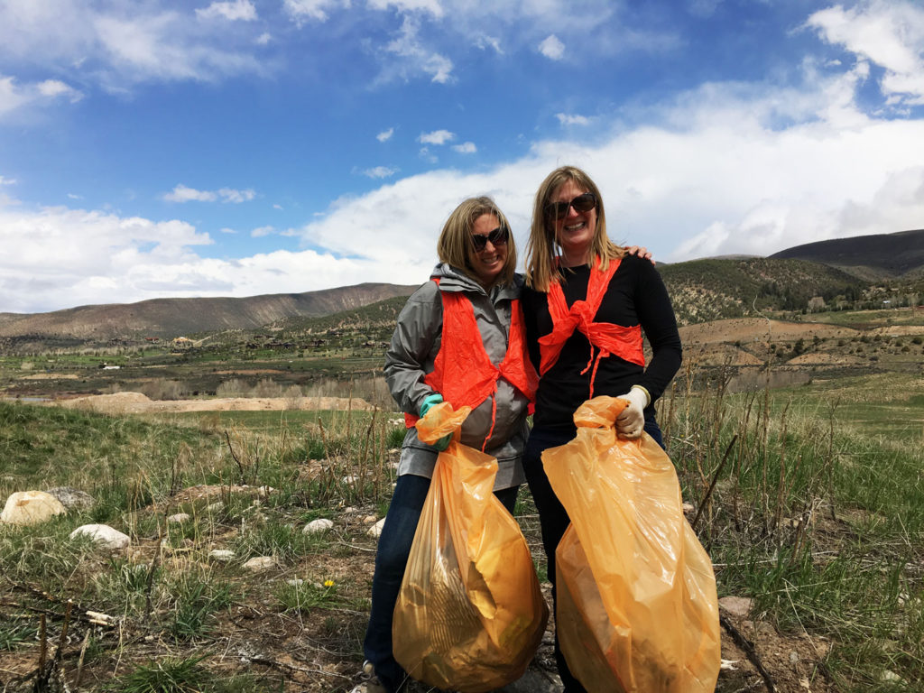 moms picking up trash on community trash pick up day