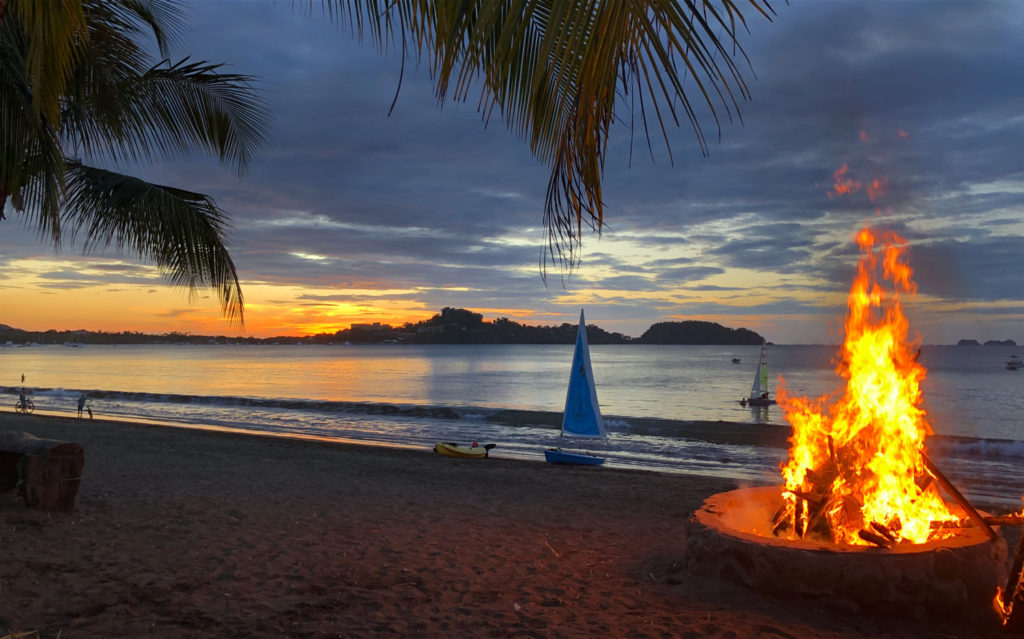 A flaming bonfire at sunset at the Costa Rica Sailing Center.