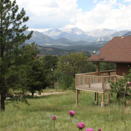 Estes Park Cabins with Rocky Mountains in background