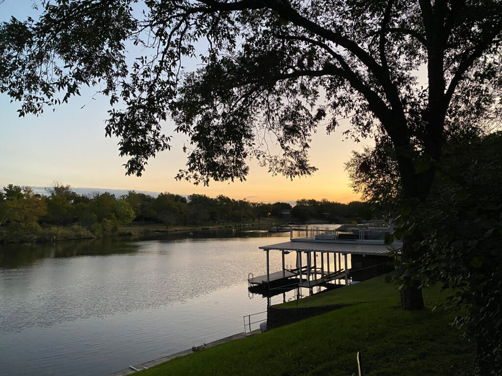 sunset at lakeside cabins in texas