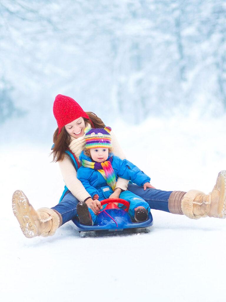 mom and child on colorado sledding hills