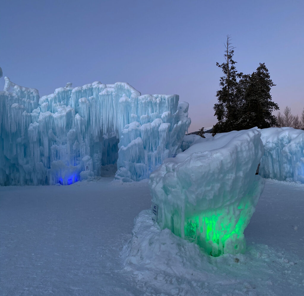 Ice Castles in Colorado lit up at night