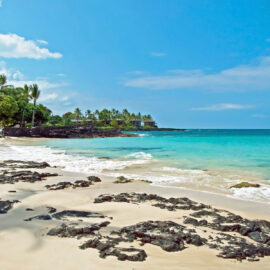 one of the beautiful white sand beaches on the big island of hawaii