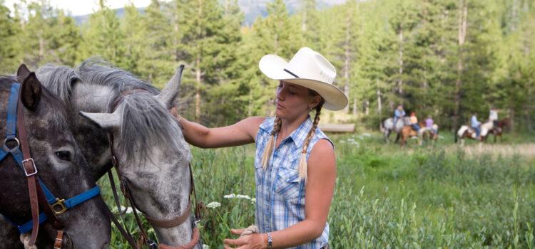 preparing to horseback ride in breckenridge