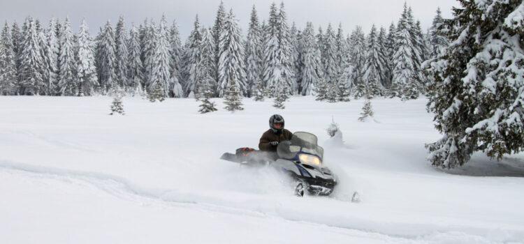 riding a snowmobile on a snowy day in breckeridge colorado